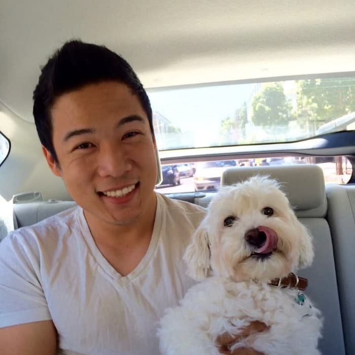 Photo of Johnny Lin with Dog
